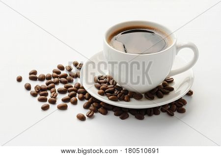 Coffee cup and saucer coffee beans on a white background.