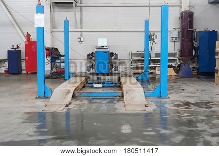 Workshop bay of wheel alignment in a car repair station in Stupino, Russia