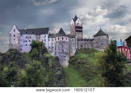 Loket Castle (Czech: Hrad Loket) is a 12th-century Gothic style castle about 12 kilometres (7 mi) from Karlovy Vary Czech Republic