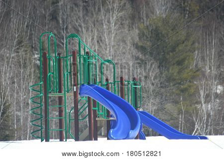 winter play ground  green blue slide trees