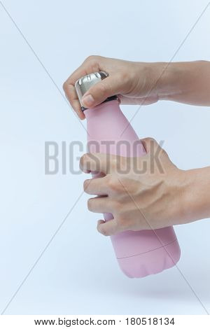 Woman hand holding warm bottle isolated on white background, stock photo