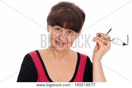 Pension age good looking smiling woman with glasses
