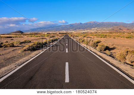 Long Empty Desert Asphalt Road in Canary Islands Spain