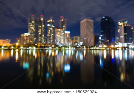 Twilight sky Office building blurred bokeh light with reflection abstract background