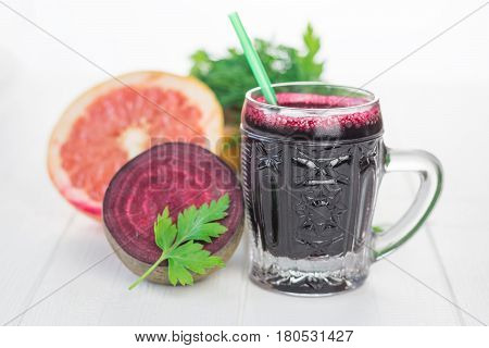 Half A Grapefruit, Half Red Beet And Beet Juice On A Wooden Table.