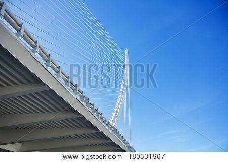 A white suspended bridge at Ciudad de las Artes y las Ciencias in Valencia Spain.