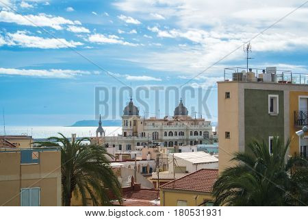 Panoramic view over the roofs of Alicante buildings near promenade and Mediterranean sea at the background Alicante Spain.