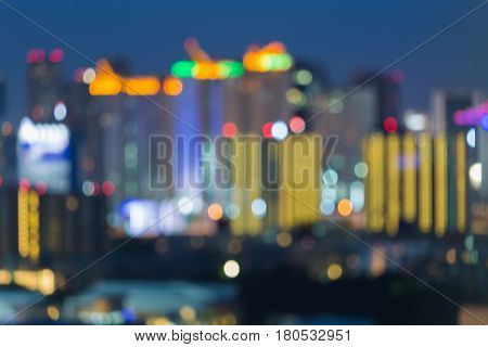 Night blurred bokeh light city downtown twilight sky abstract background