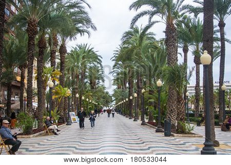 ALICANTE SPAIN - FEBRUARY 12 2016: Explanada de España a famous promenade of Alicante lanterns palms and walking and relaxing people Alicante Spain.