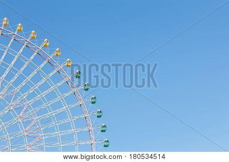Playground giant festival funfair ferris wheel against clear blue sky background