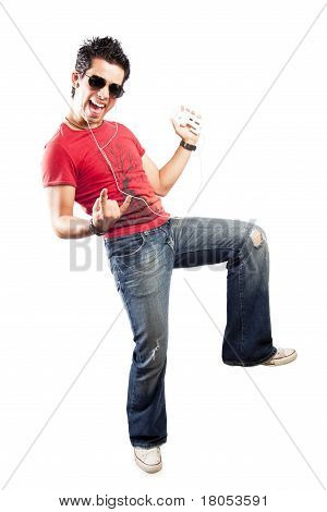 Shot Of A Trendy Teenager Listening To Music With Headphones.