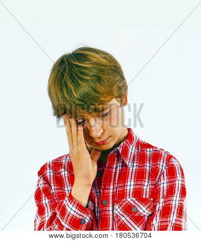portrait of boy in sorrow in red shirt