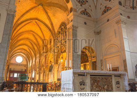 Milan, Italy - November 15, 2016: internal of main apse roof and altar of church Santa Maria Delle Grazie. Famous for hosting The Last Supper painting of Leonardo Da Vinci. left point of view.