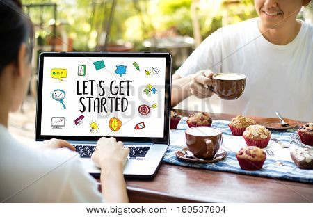 Let's Get Started Two Businessman Working At Office Desk And Using A Digital Touch Screen