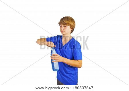 portrait of thirsty boy is drinking water