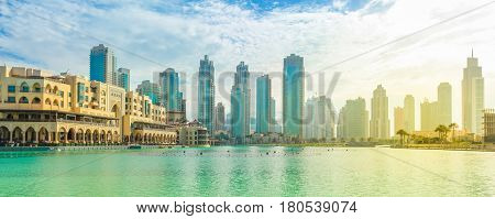 Scenic panorama view of skyscrapers at sunset of Old Town Island and Dubai Mall, around the Burj Khalifa Lake, Dubai Downtown.