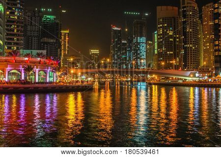 Dubai Marina illuminated at night. Dubai Marina is a modern and futuristic district that allows Dubai to place themselves in fourth place in the ranking of cities in the world with most skyscrapers.