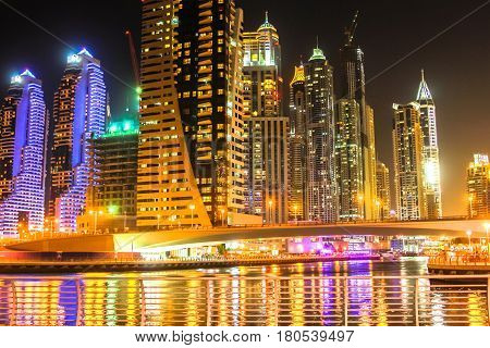 Bridge of Dubai Marina District by night. Dubai Marina is a modern district that allows Dubai to place themselves in fourth place in the ranking of cities in the world with most skyscrapers.