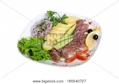 Tasty snacks, salted herring. The dish is salted herring with potatoes, lemon, pepper, onion, salad and cucumber