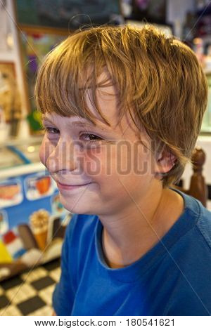 smiling boy enjoys sitting in a diners