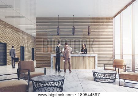Front view of a ligth wooden reception counter standing in an office lobby with marble floor and armchairs. There are people in it. 3d rendering. Double exposure
