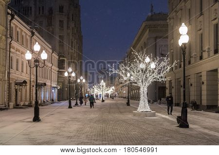 Arbat is an old street, is it a very popular pedestrian street in historical center of Moscow. Night view of the street during the New Year holidays