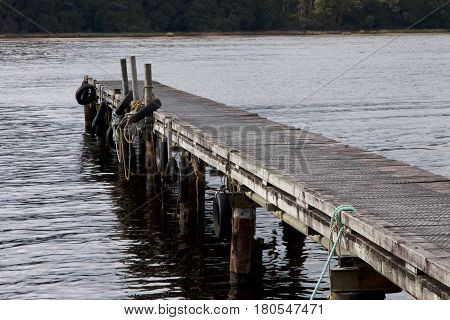 Jetty at Lettes Bay, Strahan on west coast of Tasmania, Australia