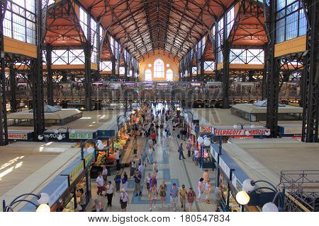 BUDAPEST - JULY 02 : People visit and go shopping in the Great Market Hall on July 02 2012 in Budapest Hungary. Great Market Hall is the largest indoor market in Budapest it was built 1896