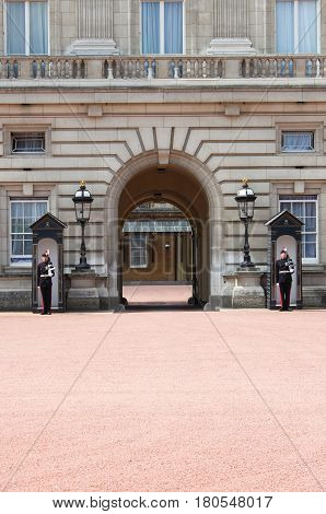 LONDON - MAY 21: Two soldiers stand guard outside Buckingham Palace on May 21 2010 in London England