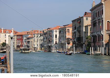 VENICE ITALY - AUGUST 5: Scenic view of Grand Canal on August 5 2012 in Venice Italy. More than 20 million tourists come to Venice annually
