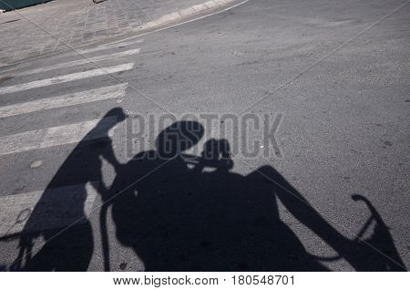 Shadow of a tourists enjoying a ride in a tuk tuk in Vietnam