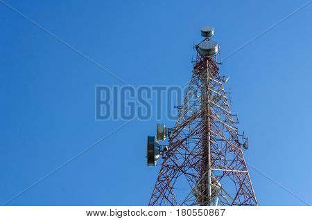 telecommunication tower with blue sky for radio television and telephony