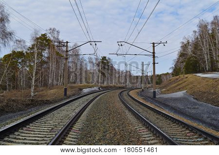 Trans-siberian railway in Siberian taiga forest in spring. Novosibirsk Siberia Russia.