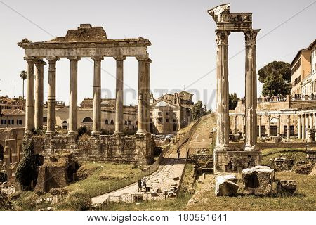 ROME, ITALY - MAY 15, 2014: Ruins of temple of Saturn on the Roman Forum in Rome, Italy.