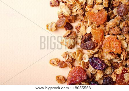 Homemade granola with honey, oatmeal, nuts, raisin, cranberry and dried apricots for background, horizontal, copy space