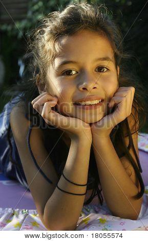 A little girl enjoying the evening sun, outdoors