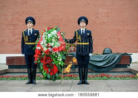MOSCOW - APRIL 28, 2016: The Honor Guard at the Tomb of the Unknown Soldier at the Kremlin Wall. The Eternal Flame burns in memory of the millions of Soviet soldiers who fell in the struggle against Nazism.