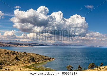 Clouds over the coastline of Titicaca lake, Bolivia