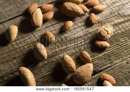 Top view of Almonds over rustic wooden background