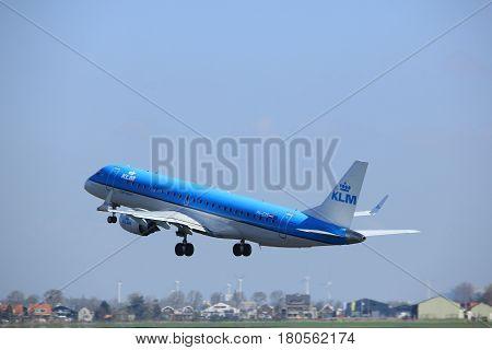 Amsterdam the Netherlands - April 2nd 2017: PH-EZS KLM Cityhopper Embraer ERJ-190STD takeoff from Polderbaan runway Amsterdam Airport Schiphol