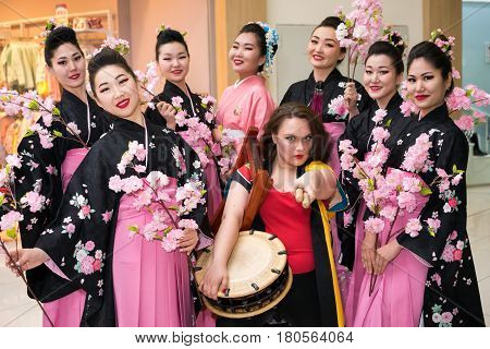 Moscow, Russia - April 02, 2017: Group Of Japanese Geisha Girls In Traditional Kimono And Taiko Drum
