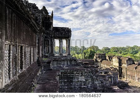 Angkor Wat terrace. This is a temple complex in Cambodia and the largest religious monument in the world originally constructed as a Hindu temple. It is the country's prime attraction for visitors