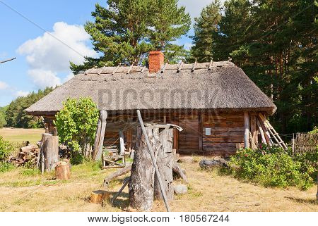 RIGA LATVIA - JUNE 13 2016: Small dwelling house (circa 1870s) of Lidumi fishermen village of Kurzeme ethnic group. Exhibited in Ethnographic Open-Air Museum of Latvia since 1957