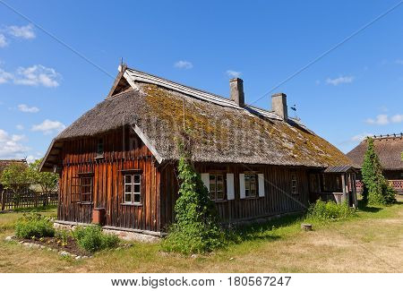 RIGA LATVIA - JUNE 13 2016: Dwelling house (circa 1880s) of Pape fishermen village of Kurzeme ethnic group. Exhibited in Ethnographic Open-Air Museum of Latvia since 1984