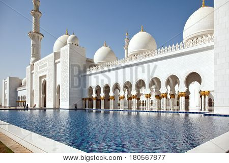 ABU DHABI UAE - March 18 2017: The Sheikh Zayed Grand Mosque in Abu Dhabi United Arab Emirates. It is the largest mosque in United Arab Emirates for more than 40000 prayers.