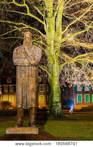 The Engels Memorial is a bronze statue of the German philosopher and communist revolutionary Friedrich Engels. It is located in Germany Wuppertal Barmen Angels Garden. Photographed in December 2016.
