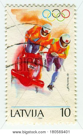 GOMEL, BELARUS, APRIL 5, 2017. Stamp printed in Latvia shows image of  The bobsled, circa 1994.