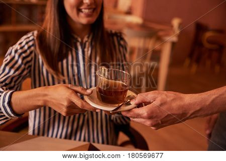 Millenial Accepting A Half Cup Of Tea