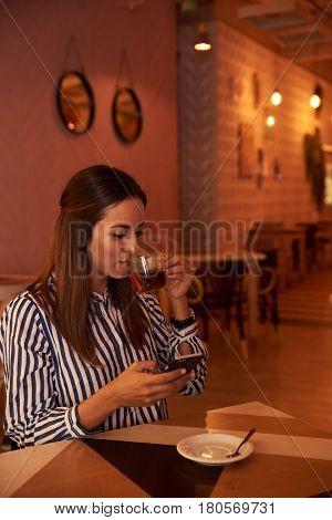 Tea Sipping Millenial In A Restaurant