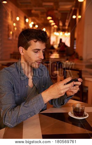 Concentrating Millenial Texting In A Restaurant